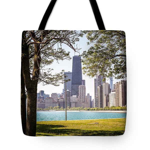 Chicago Skyline And Hancock Building Through Trees Tote Bag by Paul Velgos