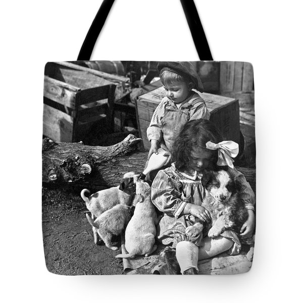 Children On Farm With Puppies Tote Bag by Underwood Archives