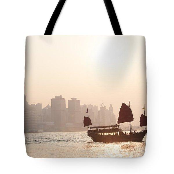 Chinese Junk Boat Sailing In Hong Kong Harbor Tote Bag
