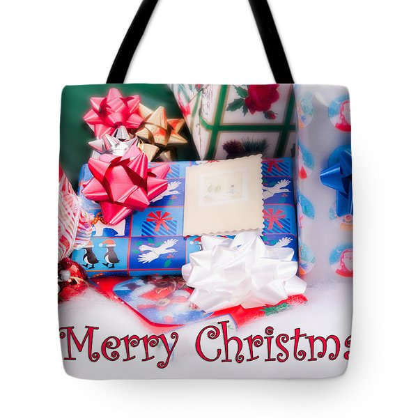 Tote Bag featuring the photograph Christmas Presents On Artificial Snow by Vizual Studio
