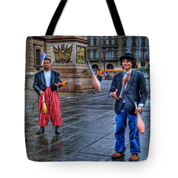 Tote Bag featuring the photograph City Jugglers by Ron Shoshani