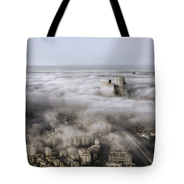 Tote Bag featuring the photograph City Skyscrapers Above The Clouds by Ron Shoshani