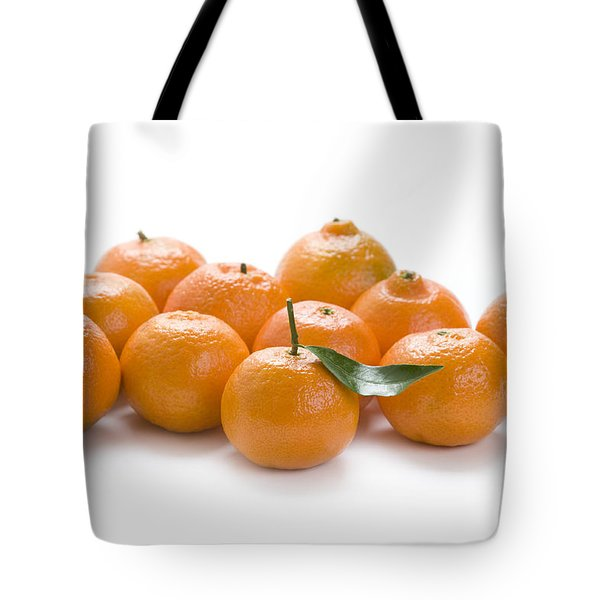 Tote Bag featuring the photograph Clementine Oranges On White by Lee Avison