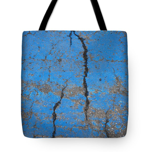 Close Up Of Cracks On A Blue Painted Tote Bag by Perry Mastrovito