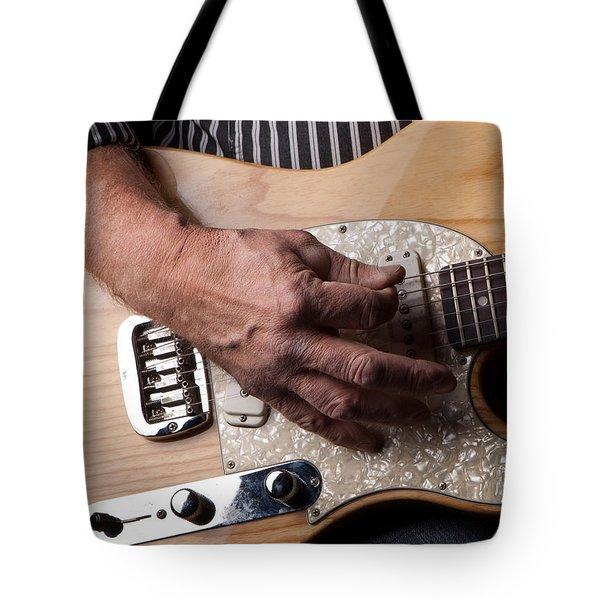 Close Up Shot Of A Man Playing An Electric Gutair Tote Bag