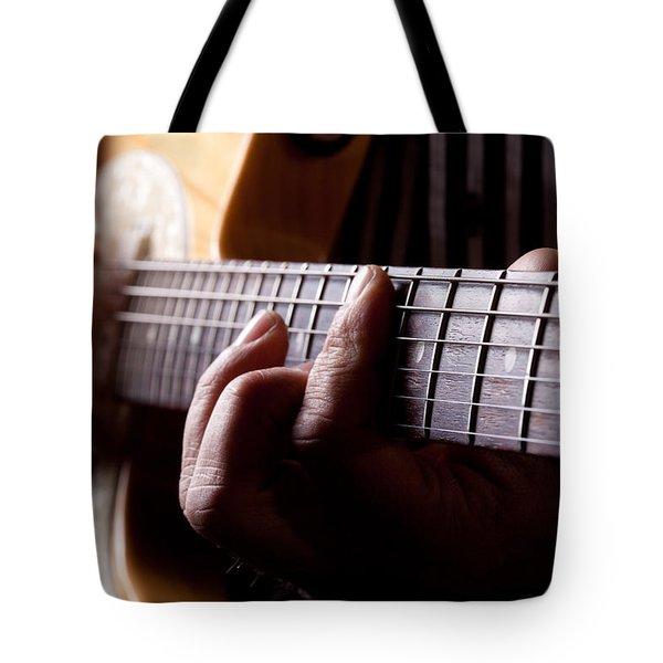 Close Up Shot Of A Man Playing Guitar Tote Bag