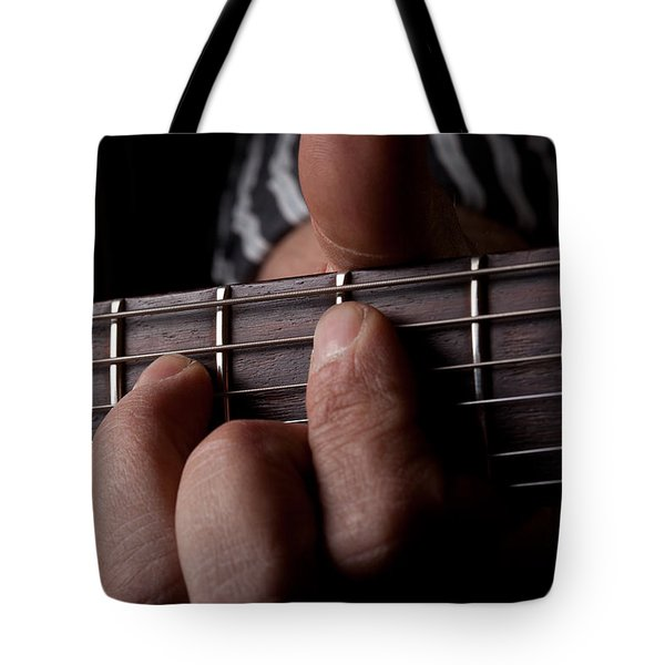 Close Up Shot Of A Mans Left Hand Playing Guitar Tote Bag