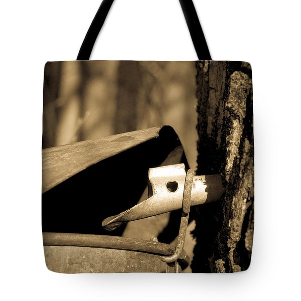 Closeup Of A Maple Tap Tote Bag by Edward Fielding