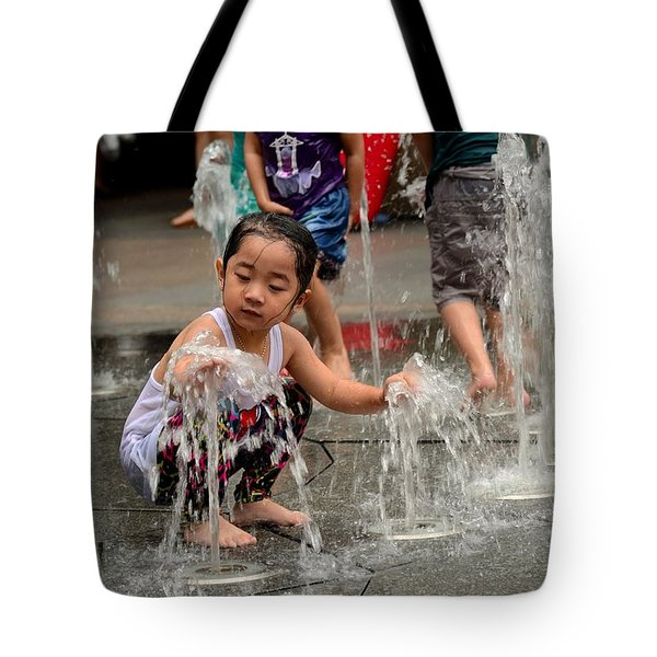 Clothed Children Play At Water Fountain Tote Bag