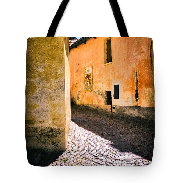 Tote Bag featuring the photograph Cobbled Street by Silvia Ganora