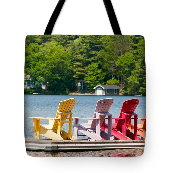 Tote Bag featuring the photograph Colorful Chairs by Les Palenik