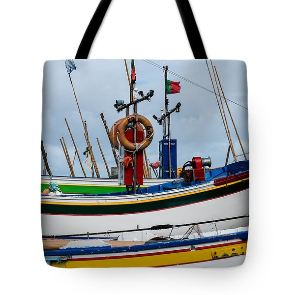 colorful fishing boat with Portuguese flag  Tote Bag
