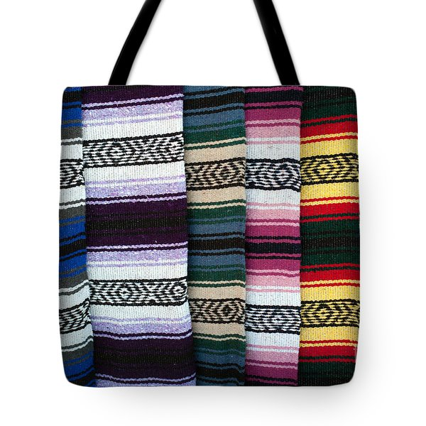 Tote Bag featuring the photograph Colorful Indian Rug Display by Gunter Nezhoda