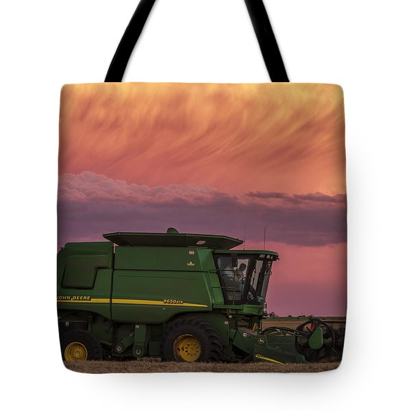 Tote Bag featuring the photograph Combine At Sunset by Rob Graham