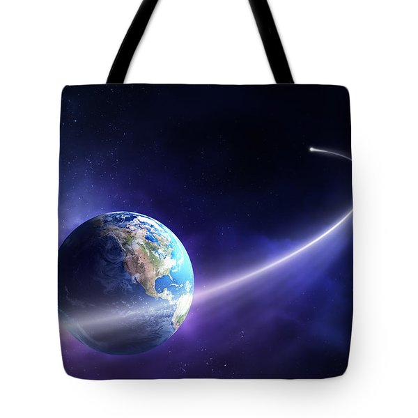 Comet Moving Past Planet Earth Tote Bag