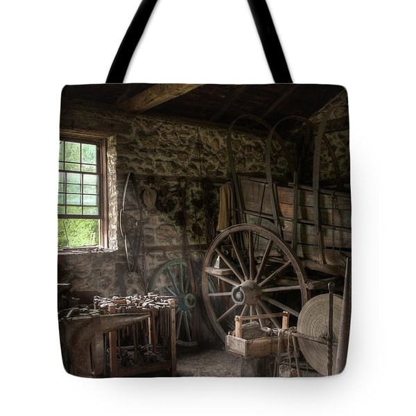 Tote Bag featuring the photograph Conestoga Wagon At The Blacksmith - Wagon Repair by Gary Heller