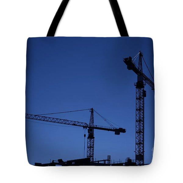 Construction Cranes At Dusk Tote Bag by Antony McAulay