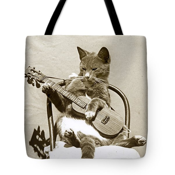 Tote Bag featuring the photograph Cool Cat Playing A Guitar Circa 1900 Historical Photo By Photo  Henry King Nourse by California Views Mr Pat Hathaway Archives