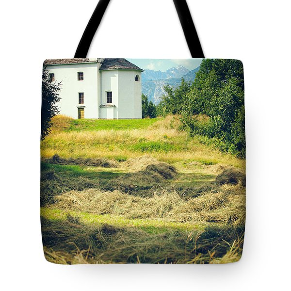 Tote Bag featuring the photograph Country Church With Hay by Silvia Ganora