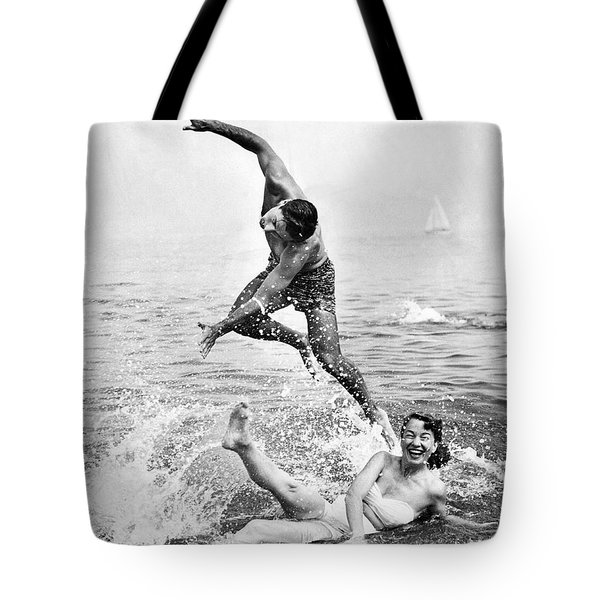 Couple Frolics In The Surf Tote Bag