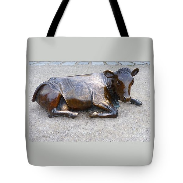 Tote Bag featuring the photograph Cow In The City by Menega Sabidussi