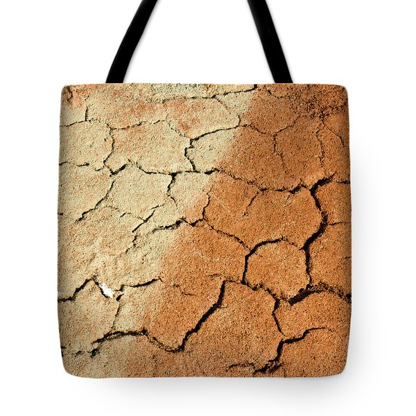 Tote Bag featuring the photograph Cracked Soil In Red Shades by Les Palenik