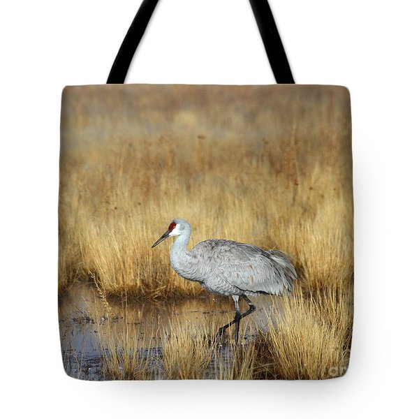 Tote Bag featuring the photograph  Solitary Crane In The Field by Ruth Jolly