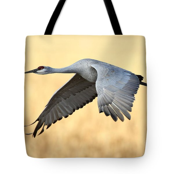 Crane Over Golden Field Tote Bag by Bryan Keil
