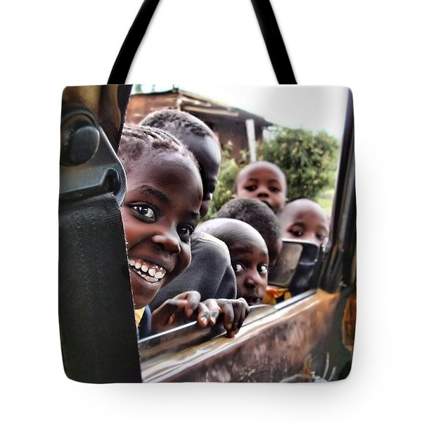 Tote Bag featuring the photograph Curiosity by Wallaroo Images