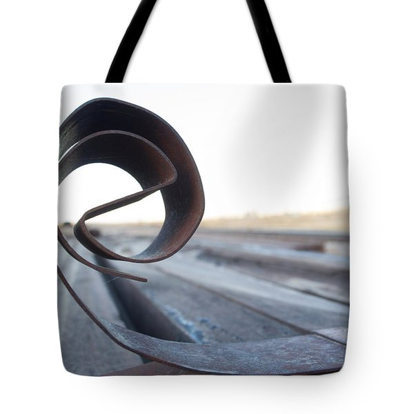 Tote Bag featuring the photograph Curled Steel by Fran Riley