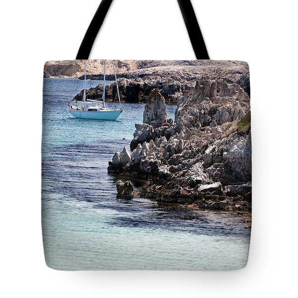 In Cala Pudent Menorca The Cutting Rocks In Contrast With Turquoise Sea Show Us An Awsome Place Tote Bag