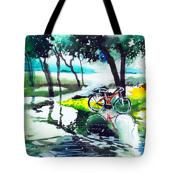 Cycle In The Puddle Tote Bag by Anil Nene