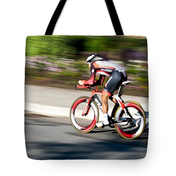 Tote Bag featuring the photograph Cyclist Racing The Clock by Kevin Desrosiers
