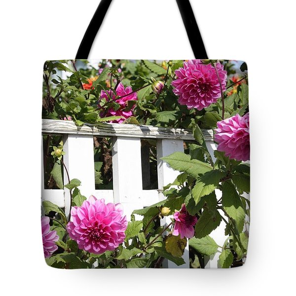 Dahlias Over The Fence Tote Bag by Carol Groenen