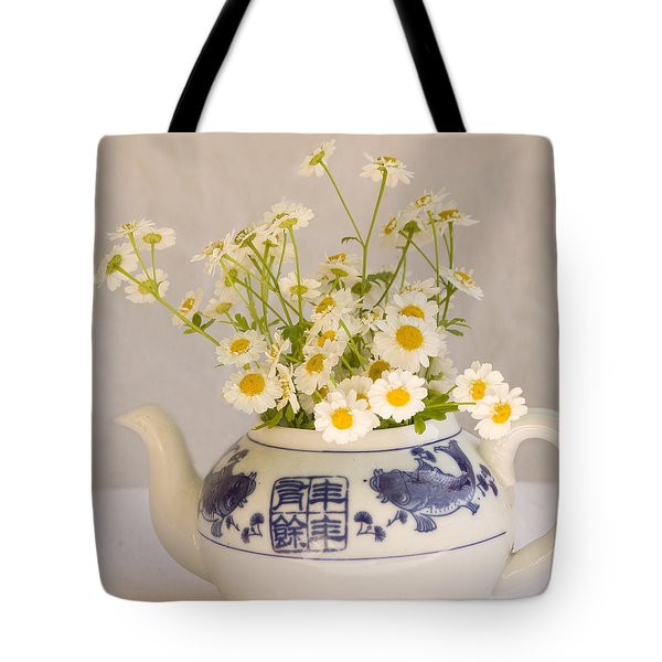 Tote Bag featuring the photograph Daisies In A Teapot by Peggy Collins