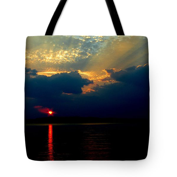 Tote Bag featuring the photograph Cloudy Sunset by James C Thomas