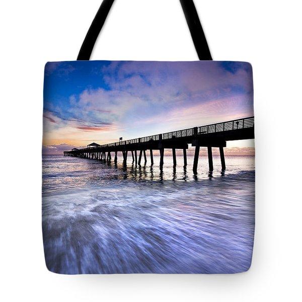 Dawn At The Juno Beach Pier Tote Bag by Debra and Dave Vanderlaan