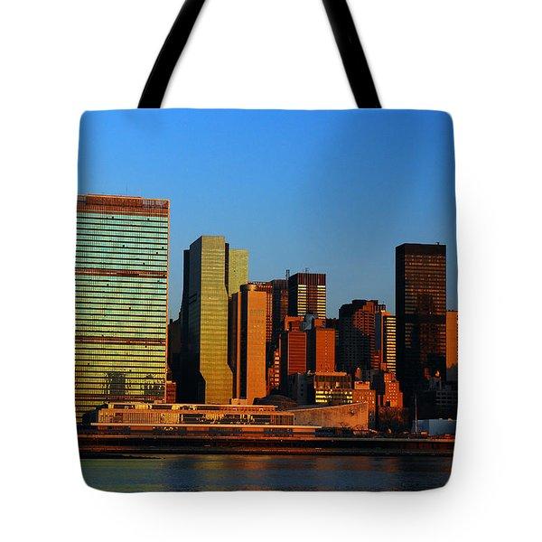 Dawn On Manhattan Tote Bag by James Kirkikis
