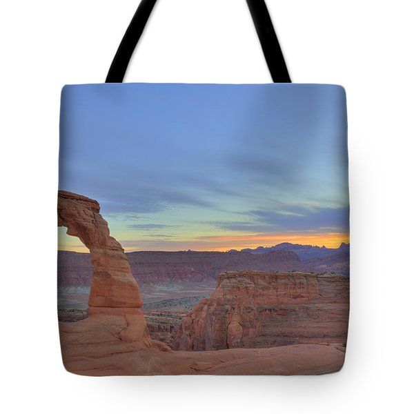 Tote Bag featuring the photograph Delicate Arch At Sunset by Alan Vance Ley