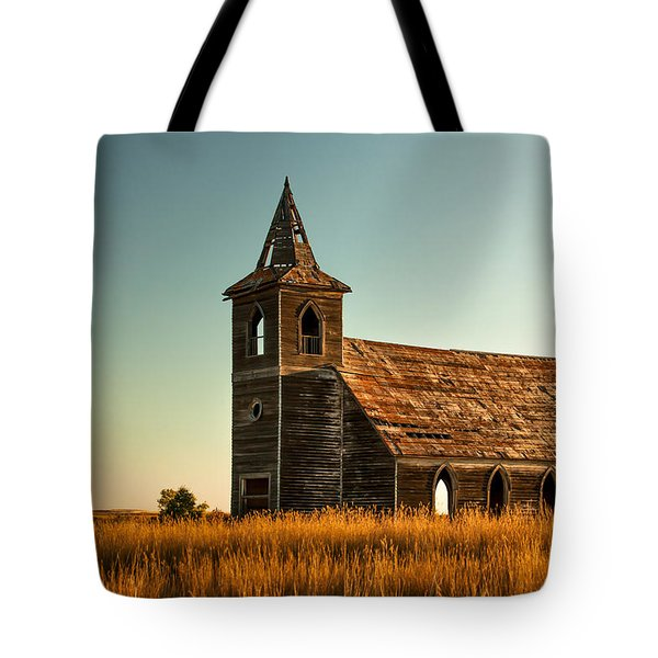 Tote Bag featuring the photograph Deserted Devotion by Todd Klassy