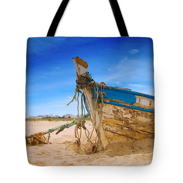 Dilapidated Boat At Ferragudo Beach Algarve Portugal Tote Bag by Amanda Elwell