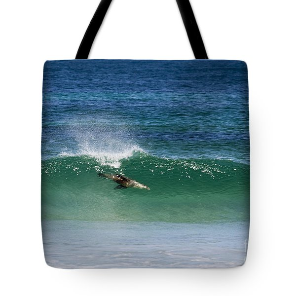 Diving Beneath The Curl Tote Bag by Mike Dawson