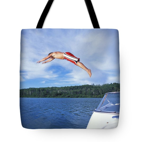 Diving Into A Lake Tote Bag