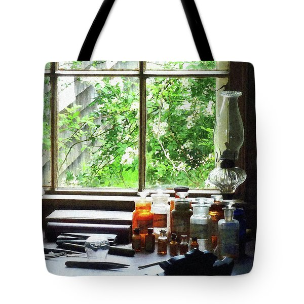 Tote Bag featuring the photograph Doctor - Medicine And Hurricane Lamp by Susan Savad
