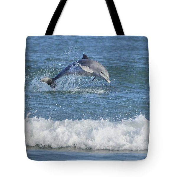 Dolphin In Surf Tote Bag