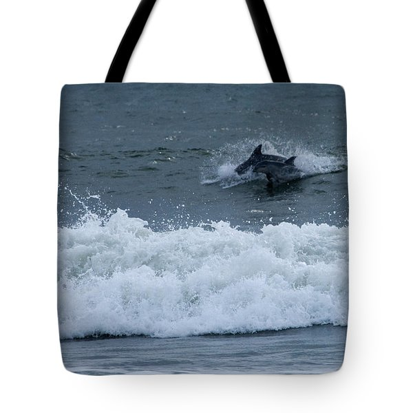 Tote Bag featuring the photograph Dolphins At Play by Greg Graham