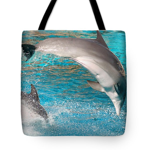 Dolphins Show Tote Bag by Michal Bednarek