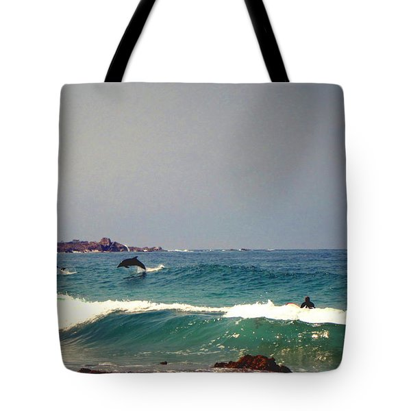 Dolphins Swimming With The Surfers At Asilomar State Beach  Tote Bag by Joyce Dickens
