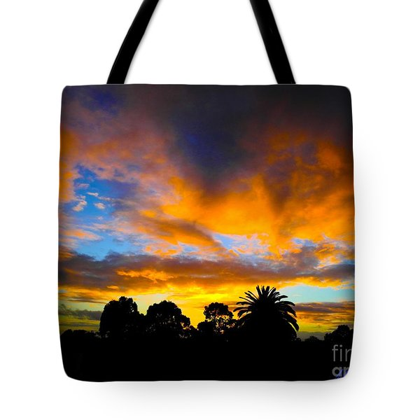 Tote Bag featuring the photograph Dramatic Sunset by Mark Blauhoefer