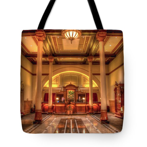 Tote Bag featuring the photograph Driskill Hotel Check-in by Tim Stanley